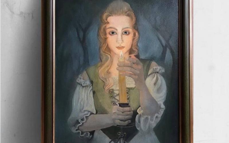žena sa svijećom